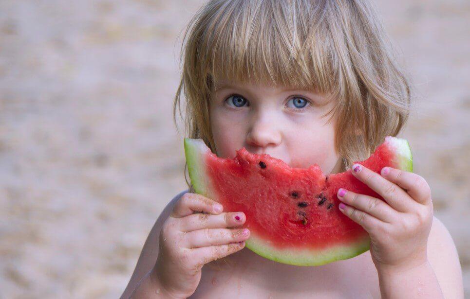 vitamins girl eating watermelon